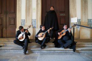 4 men singing, playing Fado music, Coimbra guitar, Portuguese guitar, Coimbra University, Portugal