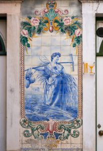 bakery, woman harvesting, beautiful tile decoration, Coimbra, Portugal