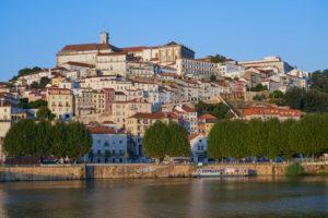 Coimbra University on hilltop, evening light, Portugal
