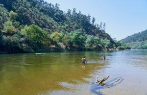 people bathing, river beach, clear water, Mondego River between Penacova & Torres, Portugal