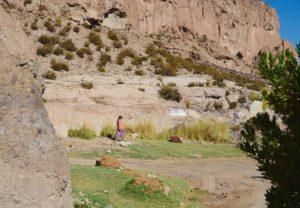 indigenous atacamena woman, walking, Caspana village, Chile, pre-Incan oasis, 3260m, steep gorge