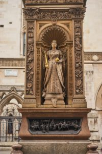 Statue Queen Victoria, orb, sceptre, frieze of journey to Guildhall, 1837, The Strand, London