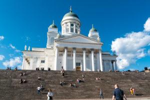 Helsinki, Senate Square, cathedral, visitors enjoy the evening sun