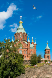 Helsinki, Uspenski Cathedral, visitors are pausing on rocks
