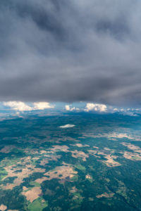 Latvia, flight, aerial photography, forest and fields, clouds, Cumulus congestus and Cumulonimbus calvus
