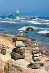 island of Rügen, coastal hiking trail, cairn, in the background Sellin pier with diving bell