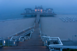 island of Rügen, baltic resort Sellin, pier in the fog, blue hour