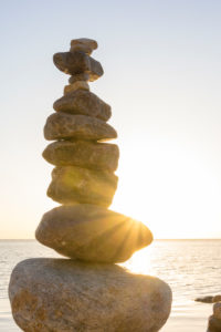 Baltic Sea, island of Rügen, cairn in the back light with sunbeams, morning mood