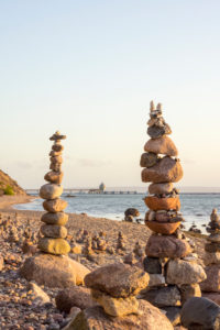 Baltic Sea, island of Rügen, cairn, morning mood, in the background Sellin pier
