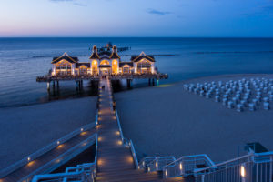 island of Rügen, baltic resort Sellin, pier and beach chairs, illuminated, blue hour