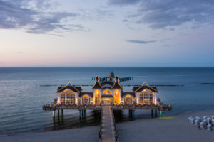island of Rügen, baltic resort Sellin, pier, illuminated restaurant, blue hour