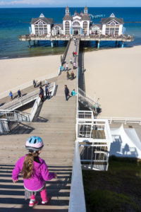 island of Rügen, baltic resort Sellin, stairs to the pier, child with bicycle helmet