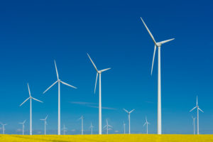 Wind turbines in front of blue sky, symbol image. Wind power, renewable energy