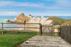 Spain, north coast, Cantabria, Costa Quebrada, Geopark, beach, Playa el Portio, fence