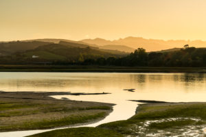 Spain, north coast, Cantabria, San Vicente de la Barquera, Rio Escudo at low tide, estuary
