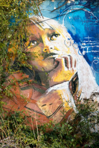 Spain, Granada, Realejo, street art by artist Raul Ruiz, child's portrait