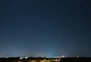 Night sky over Berlin, shooting star from the swarm of lyrids