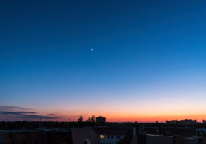 Crescent moon and Venus at dusk in the western sky over Berlin