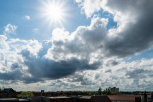 Berlin, distant view to the west, sun with rays and dramatic clouds, cumulus