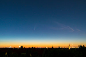 "Comet ""Neowise"" (C / 2020 F3) over Berlin, dawn, distant view to the east, television tower"