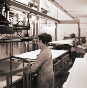 Young women at work in a cardboard box factory from the GDR period around 1968