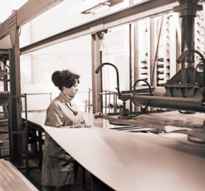Young woman at work in a cardboard packaging plant from the GDR period around 1968