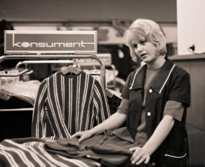Young saleswoman in the 1968 newly opened consumer department store on Bruehl in Richard-Wagner-Strasse in the center of Leipzig. At that time the largest department store in the GDR, popularly called tin can, because of the aluminum shell of the outer facade made in honeycomb patterns, which unfortunately heated up the house very much.