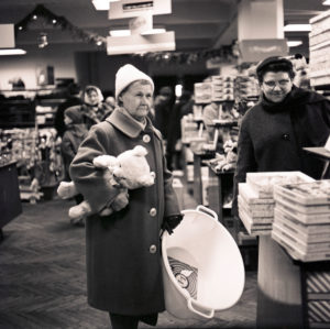 Customers in the 1968 newly opened consumer department store on Bruehl in Richard-Wagner-Strasse in central Leipzig. At that time the largest department store in the GDR, popularly called 'tin can', because of the aluminum shell of the outer facade made in honeycomb patterns, which unfortunately heated up the house very much.
