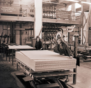 GDR era, two young women work in a particleboard plant of the Deutsche Werkstaetten Hellerau in Saxony