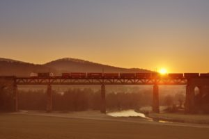 River, bridge, freight train, sunset,