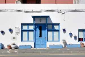 Spain, Fuerteventura, El Cotillo, house, number 15, facade, wall, blue door and window