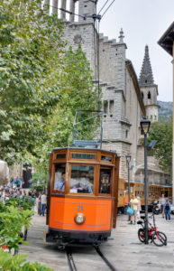 Spain, Majorca, Sóller, streetcar, church, streetcar driver, passers-by, people, pedestrian area