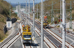 Tracks, construction vehicles, overhead line works, mechanics, work platform