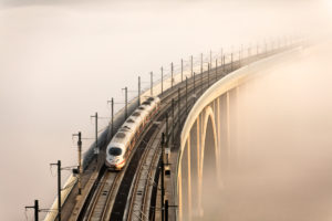 Train, overhead wire, bridge, fog