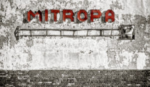 Weathered lettering Mitropa on weathered wall, digitally edited, Color Key, RailArt