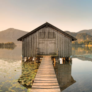 Boat hut at Kochelsee against Herzogstand and Heimgarten, Upper Bavaria, Bavaria, Germany
