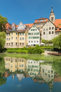 Tuebingen old town with Hölderlin tower and collegiate church reflected in the Neckar, Tuebingen, Baden-Württemberg, Germany