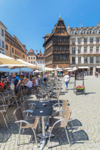 Street cafes on Place de la Cathedrale with Maison Kammerzell, Strasbourg, Alsace, France