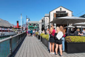 Boardwalk Seafood Restaurant on the jetty with historic steamship Earnslaw, Queenstown, Otago, South Island, New Zealand, Oceania