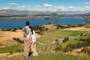 Hikers on the Roy's Peak Track enjoying the view over Lake Wanaka, Otago, South Island, New Zealand, Oceania