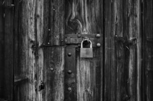Padlock at the gate of a wooden barn, Stuttgart, Baden-Württemberg, Germany