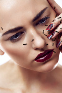 beauty composing picture with ants, head inclined, hand little bit in the look