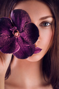 beauty, close-up, detail, head-on with orchid in front of the eye