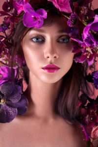 beauty close-up, detail, head-on with wreath of orchids,  pink lips