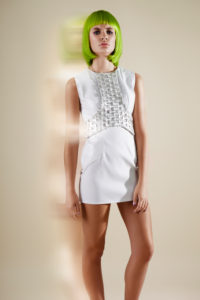 Fashion picture, head-on, pose in the camera, short hairstyle, green Bob hairstyle,