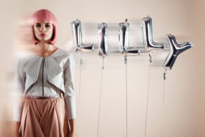 Fashion picture with hot-air balloons playful in the background, pink short hairstyle, Bob hairstyle