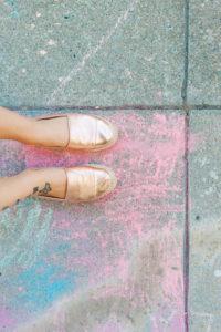 coloured sidewalk chalk, feet with summery sandals