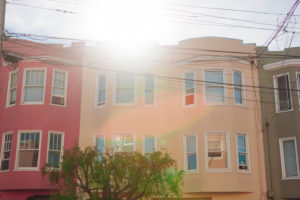 coloured house facades, the sun, back light,