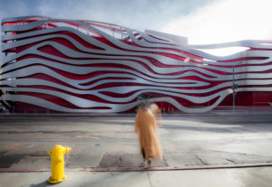 Petersen Automotive Museum of Los Angeles, facade, modern architecture, blurred person in the foreground