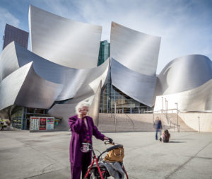 Walt Disney Concert Hall, Los Angeles, senior with walking aid in the foreground